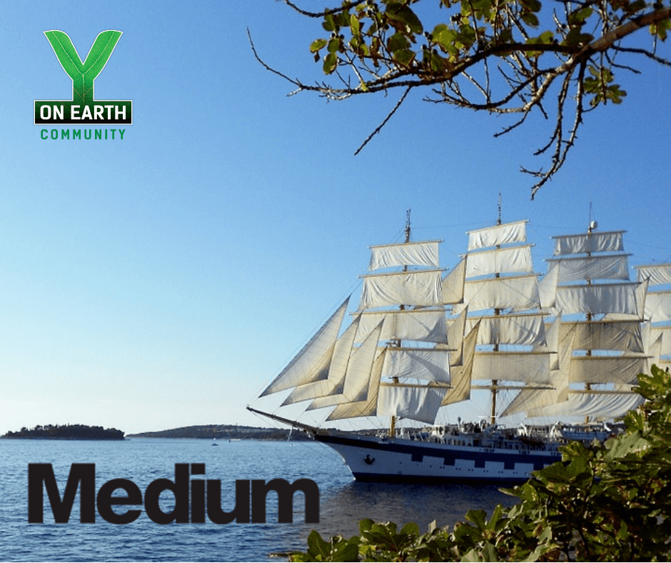 Ship Sailing on Calm Waters with Medium & Y on Earth Logos